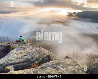 Woman with knitted hat sit in the nature reserve in Germany - Stock Photo