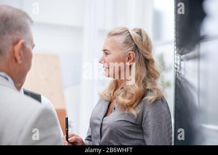 close up. senior Manager talking to employees. - Stock Photo