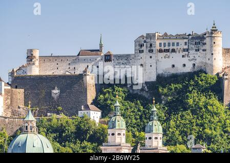 Hohensalzburg Fortress sits atop the Festungsberg, a small hill in the Austrian city of Salzburg. Erected at the behest of the Prince-Archbishops of S - Stock Photo