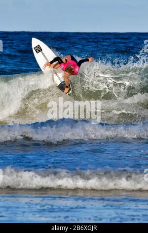 Bronte Macaulay competing in the Sydney Surf Pro 2020 - Stock Photo