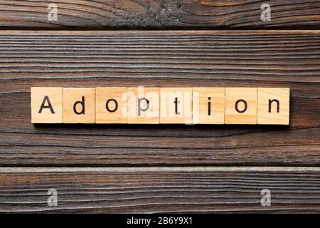 adoption word written on wood block. adoption text on table, concept. - Stock Photo
