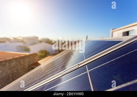 Solar energy storage panels on the roof of a house in a Portuguese city. Clean green energy