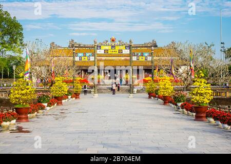 Thai Hoa Palace (Hall of Supreme Harmony) beyond the Bridge of Golden Water, Imperial City, Hue, Thua Thien-Hue Province, Vietnam - Stock Photo