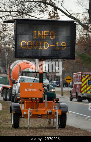 Coronavirus sign, Lexington, Massachusetts, USA – 12 March 2020: Sign on Bedford Street at the entrance to Lexington, Massachusetts.  As of March 12 2020 a small number of Lexington residents are suspected of having the COVID-19 virus.  All public schools have been closed until at least March 27th affecting 7,000 students.   Lexington, population of about 33,000, is a town less than 7 miles northwest of Boston, MA, and is known as the place where the first shot of the American Revolutionary War was fired. - Stock Photo