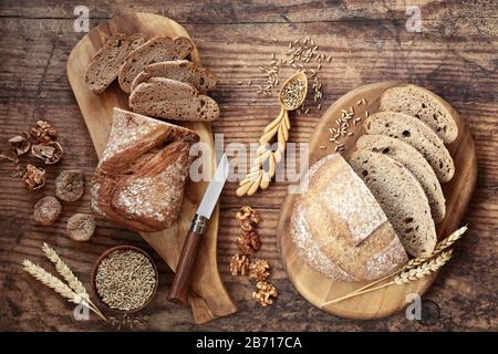 High fibre fig & walnut rye bread with sourdough loaf, loose grain walnuts and figs. High in vitamins, antioxidants and omega 3. - Stock Photo