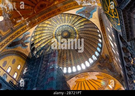 The main golden dome as seen from inside on the ground floor of the ancient Hagia Sophia in Istanbul, Turkey. - Stock Photo