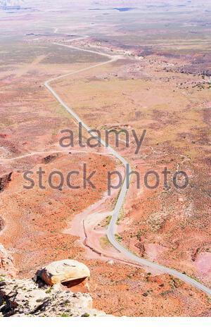 Winding roadway cutting through Valley of the Gods, Utah, USA, - Stock Photo