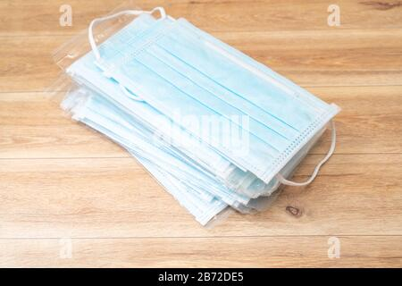 Surgical mask with rubber ear straps. Typical 3-ply surgical mask to cover the mouth and nose. Procedure mask from bacteria. Protection concept. - Stock Photo