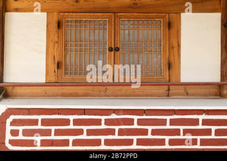 Traditional house in Bukchon Hanok village, Seoul, South Korea - Stock Photo