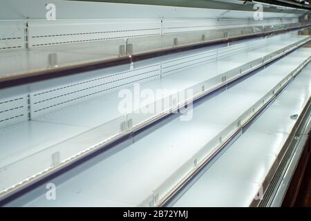 empty shelf for products in the supermarket. Equipment for retail stores. - Stock Photo