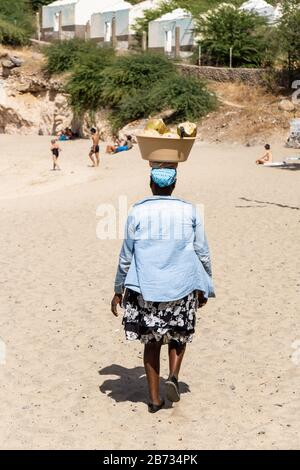 Woman with coconuts in Tarrafal, Santiago Island, Cabo Verde, Cape Verde, green island and Volcano Island, Atlantic, Atlantic Ocean, African style - Stock Photo