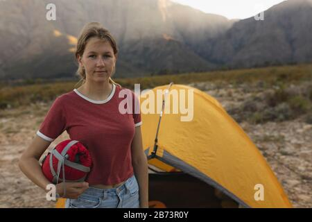 Front view of woman looking at the camera - Stock Photo