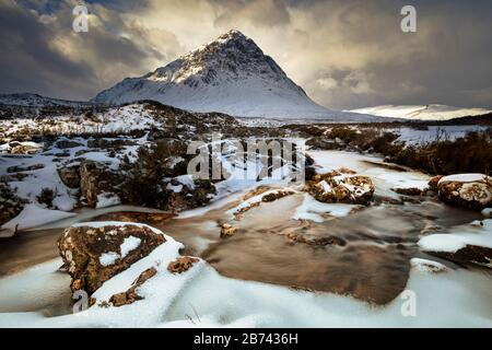 Dramatic Snow covered Buachaille Etive Mor and the River Coupall Rannoch moor Glen Coe Scottish Highlands Scotland UK GB  Europe Stock Photo