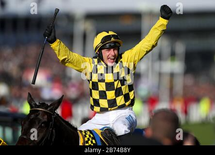 Jockey Paul Townend celebrates winning the Magners Cheltenham Gold Cup Chase with Al Boum Photo during day four of the Cheltenham Festival at Cheltenham Racecourse.