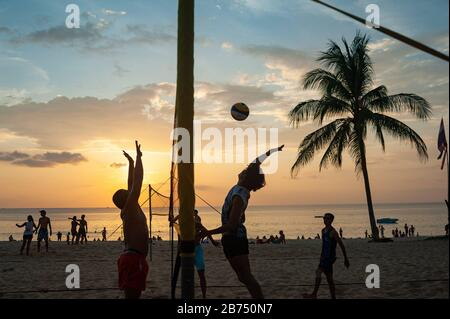 18.11.2019, Phuket, Thailand, Asia - A group of locals play volleyball at sunset on Karon Beach. [automated translation] - Stock Photo