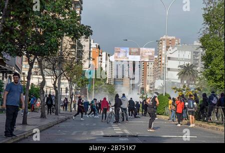 Chile, Santiago, 19.10.2019. Santiago in state of emergency on 19.10.2019. Demonstrators. The violent protests had started after a fare increase of the subway in Santiago. Chile's president Sebastian Piñera then declared a state of emergency on Friday evening. After renewed arson attacks on subway stations, a curfew was imposed in the Chilean capital on Saturday. [automated translation] - Stock Photo
