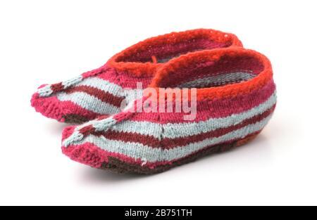 Hand knitted slipper socks isolated on white - Stock Photo