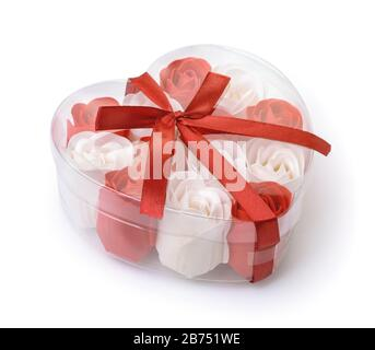 Heart shaped box full of rose soap flowers isolated on white