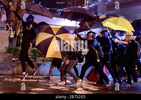 Protesters confront with the police on the 5th anniversary of umbrella movement in Admiralty. Police use water cannon to disperse them. - Stock Photo