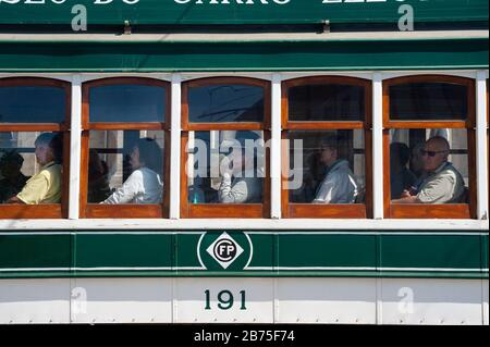 14.06.2018, Porto, Portugal, Europe - Tourists look out of the window during a tram tour of Porto. [automated translation] - Stock Photo