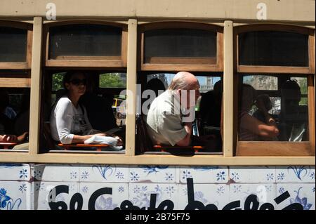 15.06.2018, Porto, Portugal, Europe - Tourists look out of the window during a tram tour of Porto. [automated translation] - Stock Photo
