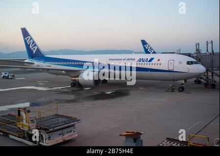 23.12.2017, Osaka, Japan, Asia - Passenger planes of ANA park on the apron of Kansai International Airport. ANA is a member of the Star Alliance, an international network of airlines. [automated translation] - Stock Photo