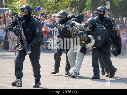 Police officers of the Berlin special task force, SEK, simulated an attack on 11.09.2016. The SEK presented its work during the open day at the Berlin state police school. [automated translation] - Stock Photo