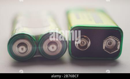 Two different types of batteries on the table close-up - Stock Photo