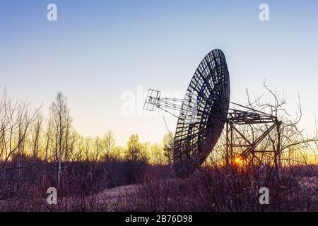 radio telescope dish satellite equipment at sunset landscape