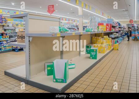 Yiewsley, London, UK - March 13, 2020 - empty shelves in Aldi supermarket; people are panic buying in anticipation of coronavirus lockdown