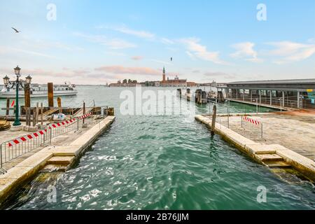 View from the Riva degli Schiavoni promenade looking across at the Church of San Giorgio Maggiore and it's bell tower in Venice, Italy. Stock Photo