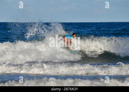 Mahina Maeda competing in the Sydney Surf Pro 2020 - Stock Photo