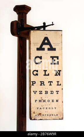 Eye test chart, 1900s. An eye test chart is used to test a person's visual acuity. - Stock Photo