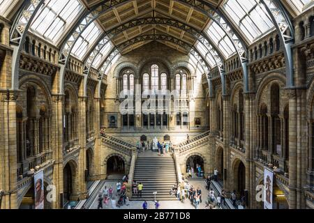 Visitors in the Natural History Museum, South Kensington, London, England.
