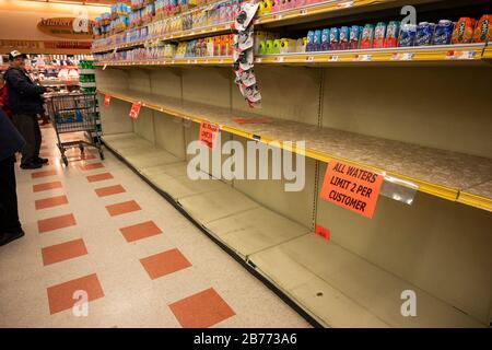 West Boylston, USA. 13th Mar, 2020. Mar 13, 2020; Leominster, MA, USA; Jugs of water were completely sold out as shoppers packed into Market Basket in Leominster to stock up on groceries late in the morning on Friday, March 13, 2020. Mandatory Credit: Ashley Green/Worcester Telegram & Gazette via USA TODAY NETWORK/Sipa USA Credit: Sipa USA/Alamy Live News - Stock Photo