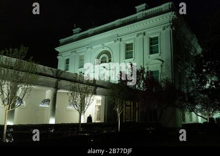 Washington, United States Of America. 11th Mar, 2020. President Donald J. Trump walks along the Colonnade of the White House to the Residence Wednesday, March 11, 2020, following his address to the Nation. People: President Donald Trump Credit: Storms Media Group/Alamy Live News Stock Photo