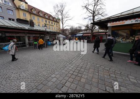 Munich, Germany. 14th Mar, 2020. The Viktualienmarkt, which is otherwise well attended at lunchtime, is only slightly frequented. Credit: Peter Kneffel/dpa/Alamy Live News