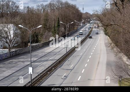 Munich, Germany. 14th Mar, 2020. Quiet traffic prevails on the middle ring road of the Bavarian state capital. Credit: Peter Kneffel/dpa/Alamy Live News