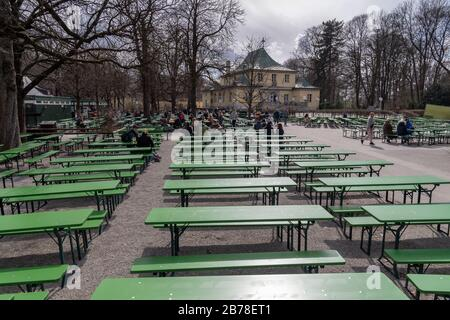 Munich, Germany. 14th Mar, 2020. There are still many free beer benches in the beer garden at the Chinese Tower in the English Garden. Credit: Peter Kneffel/dpa/Alamy Live News