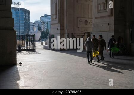 March 8, 2020, Milan, Italy: Soldiers seen at the entrance of Milano Central Station following the corona virus outbreak..The Italian Government issued a decree declaring all Lombardy region and other 14 provinces as red zones and by preventing mass social activities, the Government hopes to contain the spreading of the corona virus. (Credit Image: © Valeria Ferraro/SOPA Images via ZUMA Wire) - Stock Photo