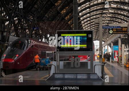 March 8, 2020, Milan, Italy: Departure hall with a screen board explaining Coronavirus symptoms following the corona virus outbreak..The Italian Government issued a decree declaring all Lombardy region and other 14 provinces as red zones and by preventing mass social activities, the Government hopes to contain the spreading of the corona virus. (Credit Image: © Valeria Ferraro/SOPA Images via ZUMA Wire) - Stock Photo
