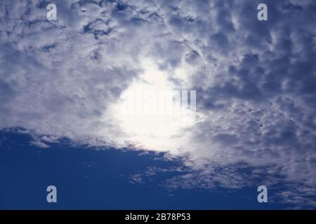glowing sun on the blue sky - Stock Photo