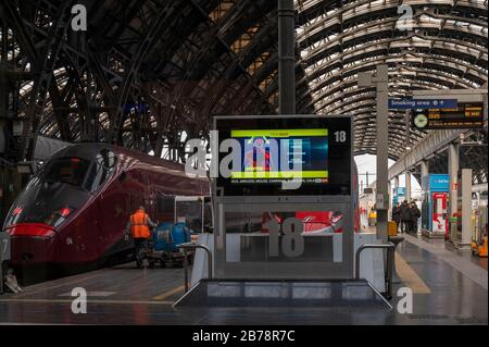 Milan, Italy. 08th Mar, 2020. Departure hall with a screen board explaining Coronavirus symptoms following the corona virus outbreak.The Italian Government issued a decree declaring all Lombardy region and other 14 provinces as red zones and by preventing mass social activities, the Government hopes to contain the spreading of the corona virus. Credit: SOPA Images Limited/Alamy Live News - Stock Photo