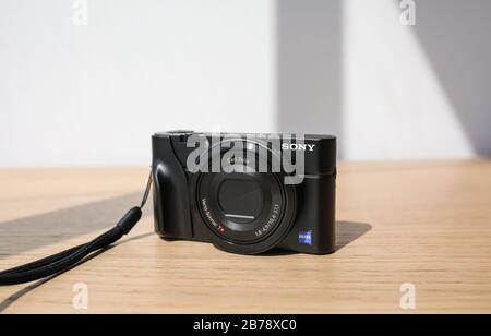Shanghai, China - Sep 17 2015: Sony DSC-RX100 black digital pocket camera - Stock Photo