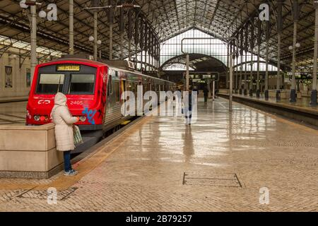 Lisbon, Portugal - 3 March 2020: Regional red train at Rossio Railway Station - Stock Photo
