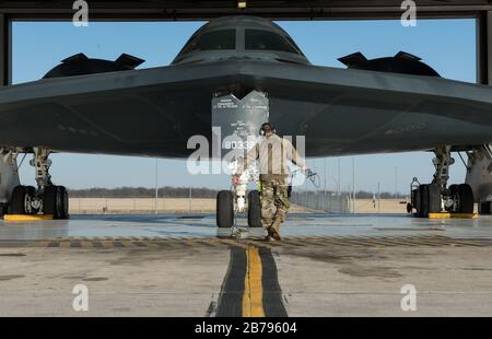 U.S. Air Force Tech. Sgt. Justin Aeckerle, a B-2 Spirit crew chief assigned to the 131st Maintenance Squadron, prepares a B-2 Spirit stealth strategic bomber for departure at Whiteman Air Force Base for relocation to England March 8, 2020 in Knob Noster, Missouri. - Stock Photo