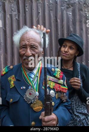 Ethiopian veteran from the italo-ethiopian war with his daughter, Addis Ababa Region, Addis Ababa, Ethiopia
