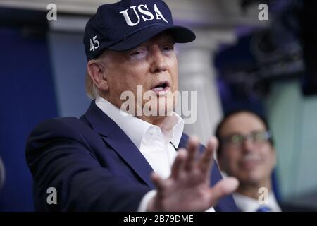 White House, Washington, USA. 14th Mar, 2020. President Donald J. Trump speaks during a COVID-19 coronavirus press briefing in the press briefing room at the White House in Washington, DC, March 14, 2020. To date there are 2175 confirmed cases of COVID-19 coronavirus in the US with 50 deaths. Photo by Shawn Thew/UPI Credit: UPI/Alamy Live News - Stock Photo