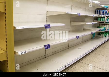 UXBRIDGE, LONDON/ENGLAND – MARCH 14 2020: TESCO store sold out of toilet roll during the 2020 Coronavirus outbreak - Stock Photo