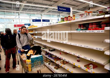 Tesco Supermarket, Hove, U.K., March 2020. Panic buying due to fears of coronavirus has emptied shelves of foodstuffs such as pasta.